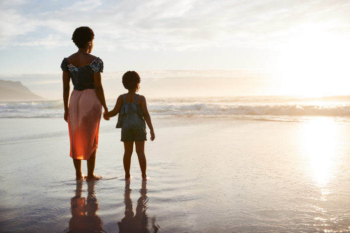 mother daughter at beach
