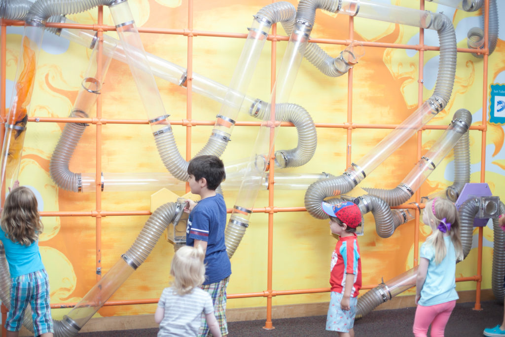 kids playing with exhibit at museum