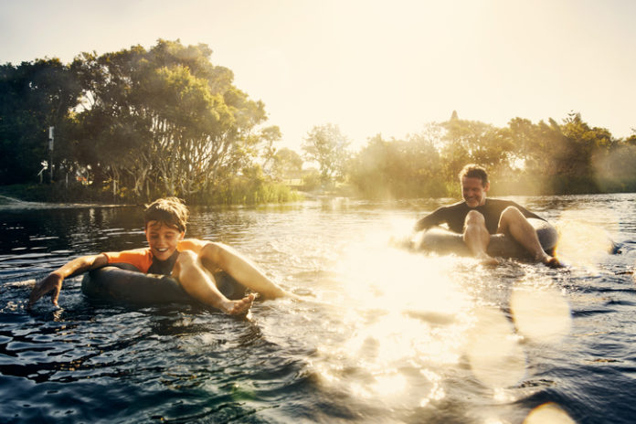 two people tubing down a river